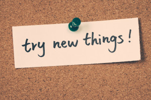 Try New Things try new things note pinned on the bulletin board